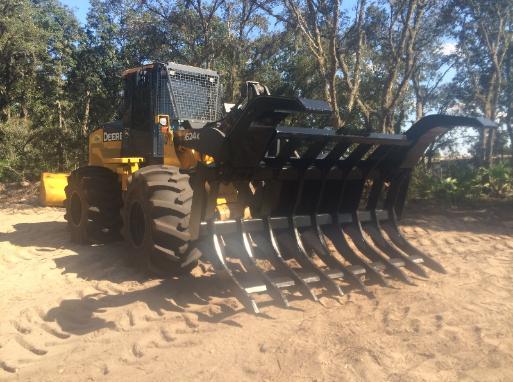 Industrial tractor backhoe wheel loader grapple root